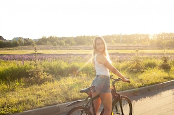 Blonde girl riding a bike
