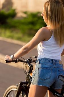 Blonde girl riding a bike