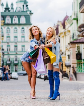 Blonde girls standing on street posing