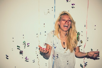 Blonde with confetti laughing