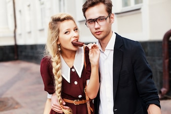Blonde woman with an ice posing with her boyfriend