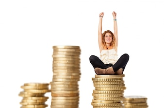 Blonde woman with columns of coins