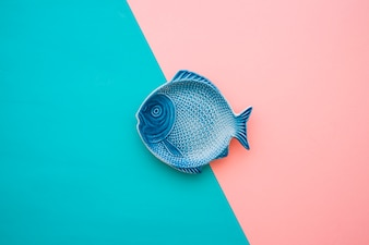 Blue and pink surface with decorative fish