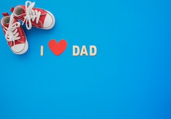 Blue background with shoes and heart for father's day