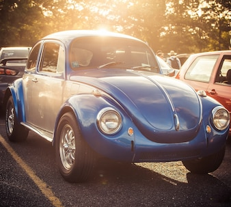Blue Beatle stands on the road