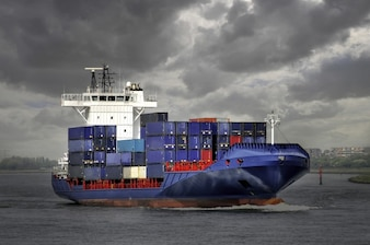 Blue container ship in a stormy day