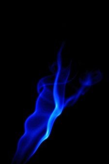 Blue flame in darkness