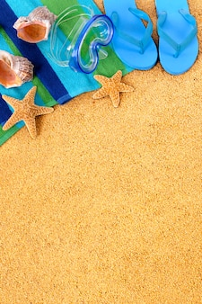 Blue flip flops on the beach