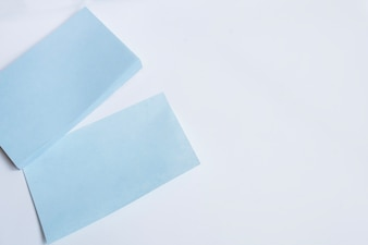 Blue papers on white