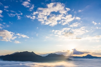 Blue sky with clouds and mountains