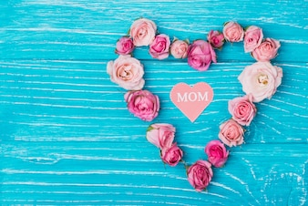 Blue surface with floral heart for mother's day