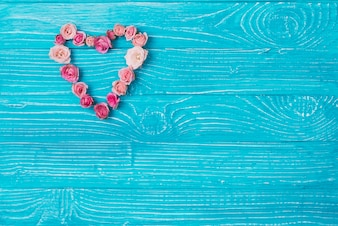Blue wooden surface with decorative floral heart