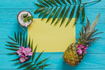 Blue wooden surface with summer fruits and blank space