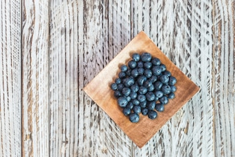 Blueberries on a wooden plate