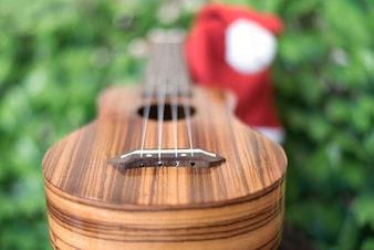 Blur ukulele with christmas hat