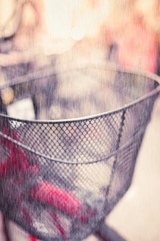 Blurred Bicycle basket with Rain in Vintage tone.