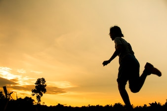 Blurred of Fitness silhouette sunrise jogging workout wellness concept