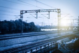 Blurred railway with sunbursts