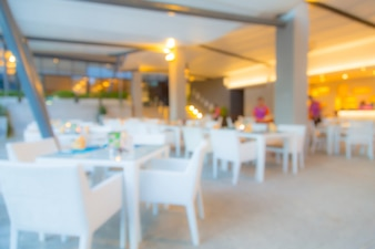 Blurred restaurant with white furniture
