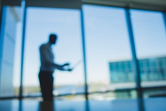 Blurred silhouette of a business man