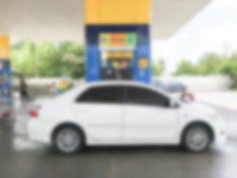 Blurred white car refuel