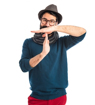 Bohemian man making time out gesture