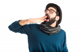 Bohemian man yawning over white background