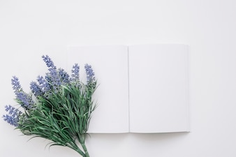 Book cover mockup with flower on left
