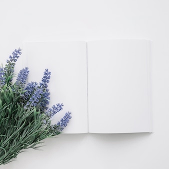 Book cover mockup with natural flowers