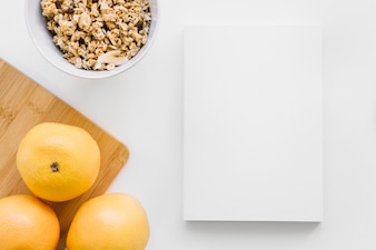 Book cover mockup with oranges and cereals