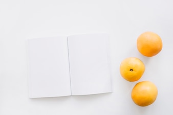 Book cover mockup with oranges