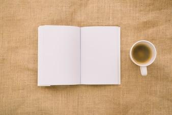 Book mockup on cloth with coffee