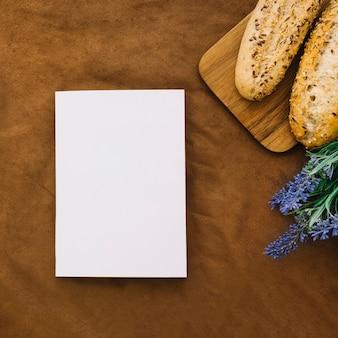 Книжный макет с хлебом и цветком