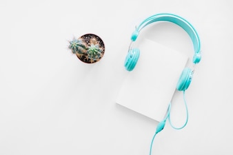 Booklet mockup with cactus and headphones