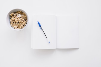 Booklet mockup with cereals and pen
