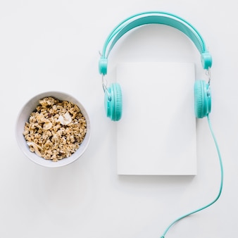Booklet mockup with headphones and cereals