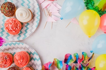 Border from muffins and birthday decorations