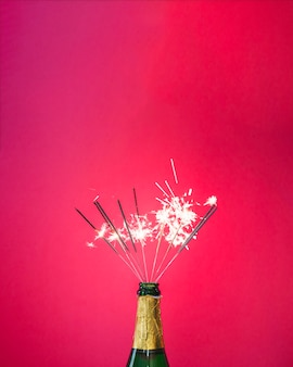 Bottle of champagne with sparklers