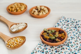 Bowl with beans on floral cloth