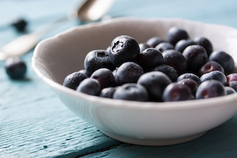 Bowl with fresh blueberries
