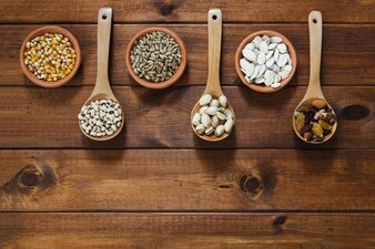Bowls and ladles with seeds and nuts