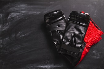 Boxing gloves on slate surface
