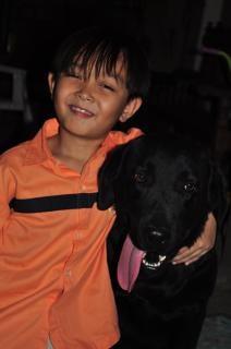 Boy and black Labrador