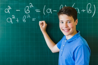 Boy calculating and posing