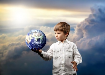 Boy holding earth globe
