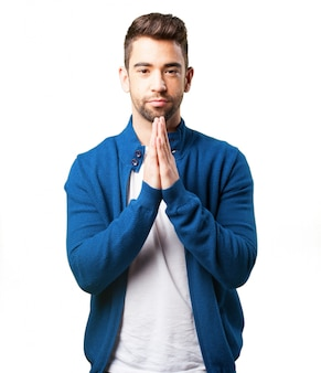Boy in a blue jacket praying