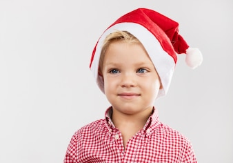 Boy smiling with santa claus hat