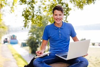 Boy studying in nature