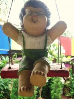 boy swing garden decoration