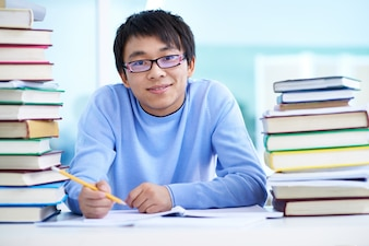 Boy with glasses in the library